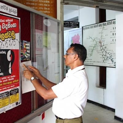 A Man Reads Npcs Anti Torture Poster In Gampaha